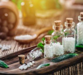 Bottles of white homeopathic pellets